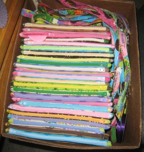box of zip pouches and laynards